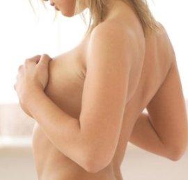 причины боли в груди перед месячными